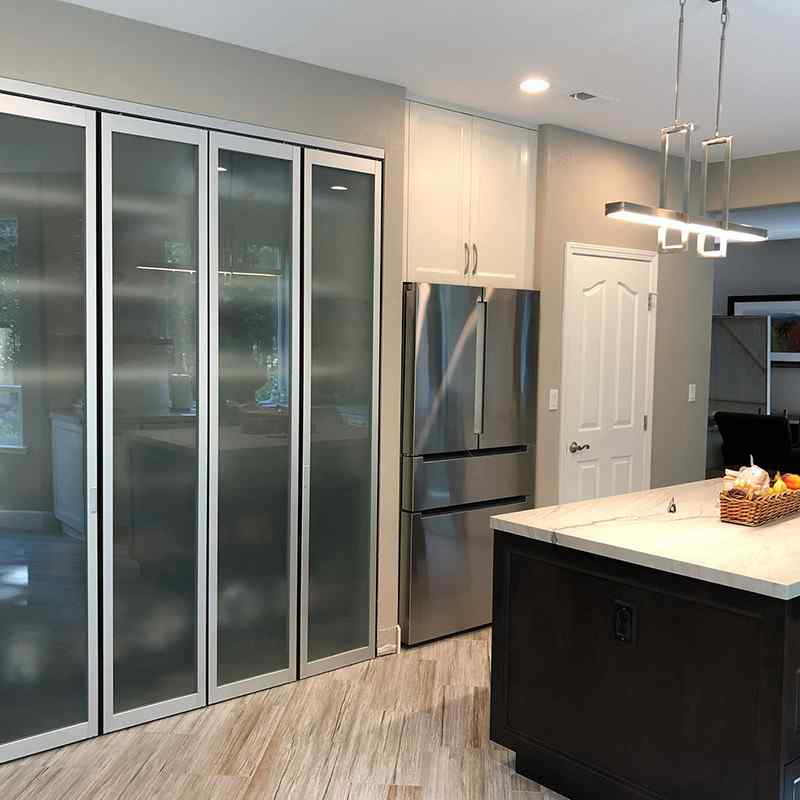 Kitchen pantry with bi folding doors with frosted glass