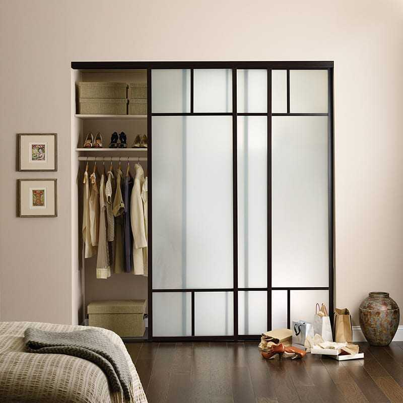 Slightly opened frosted glass closet door in a bedroom