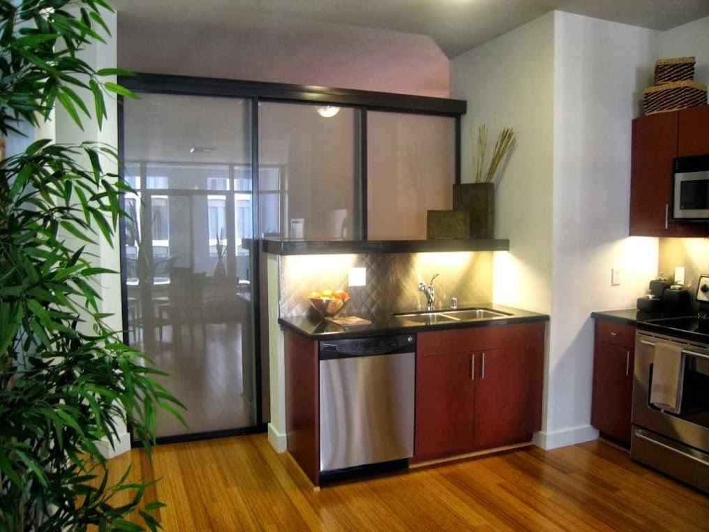 Glass Room Dividers in an Apartment Kitchen