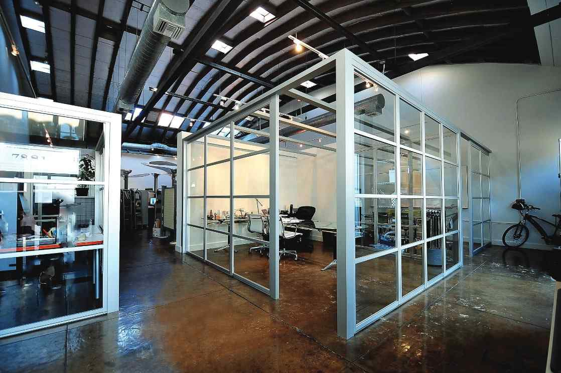 Office workspace with sliding glass doors and glass walls