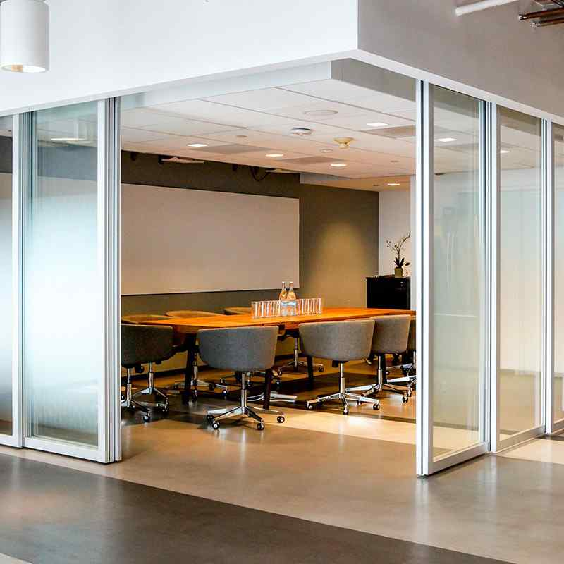 Office conference room with suspended sliding glass doors with c