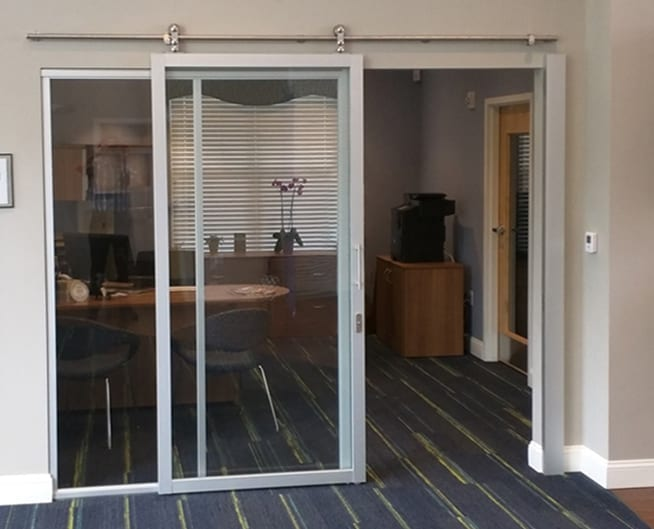 Suspended Barn Door, silver frame, clear glass, office