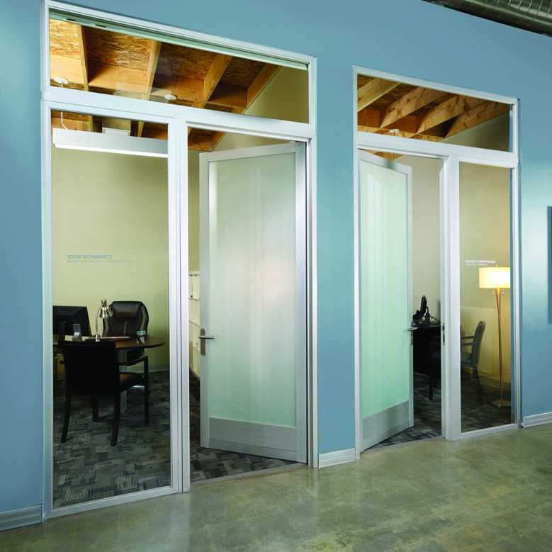 Two opened glass swing doors of small office meeting rooms