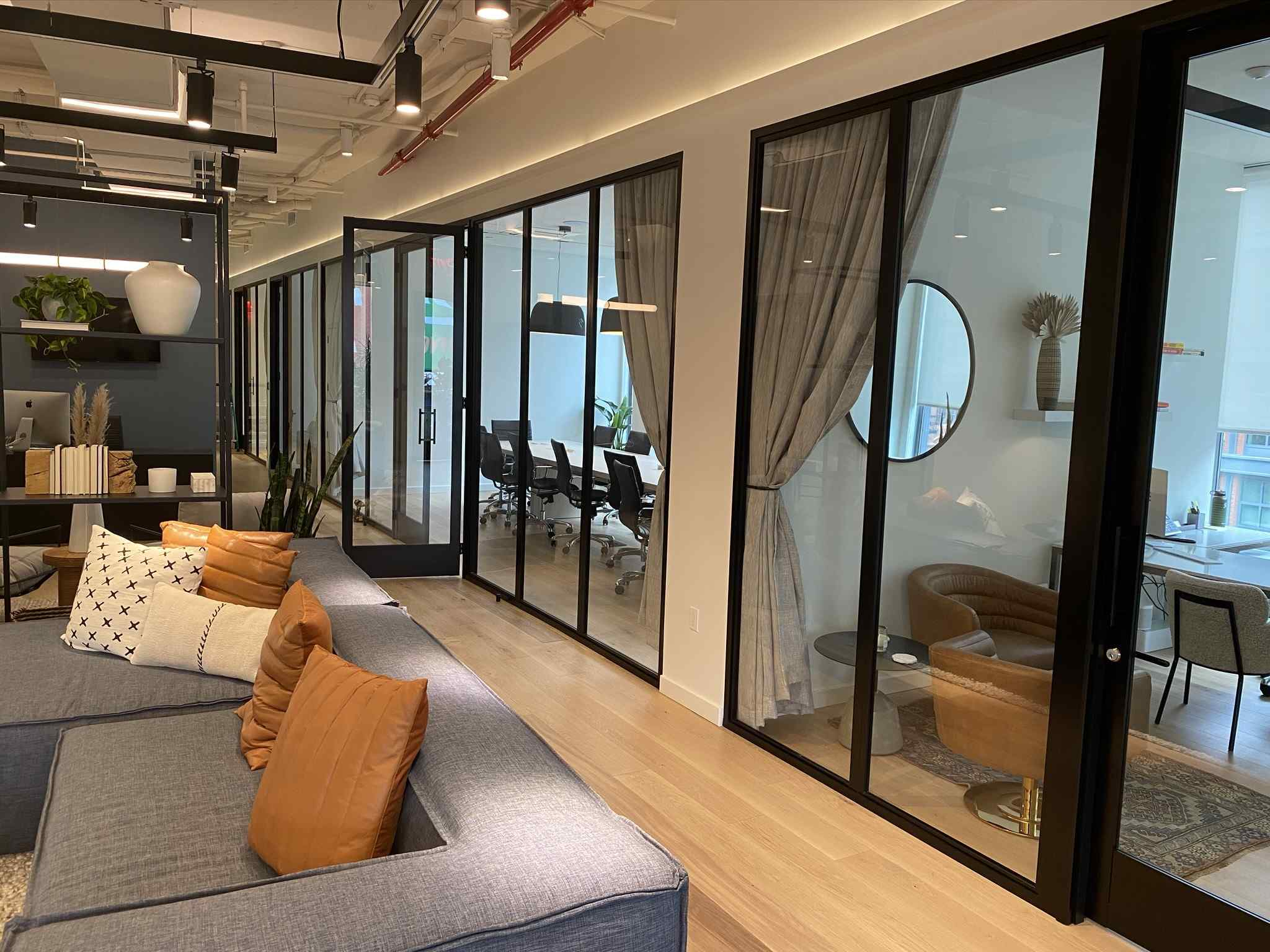 conference room with clear glass wall panels with glass swing door