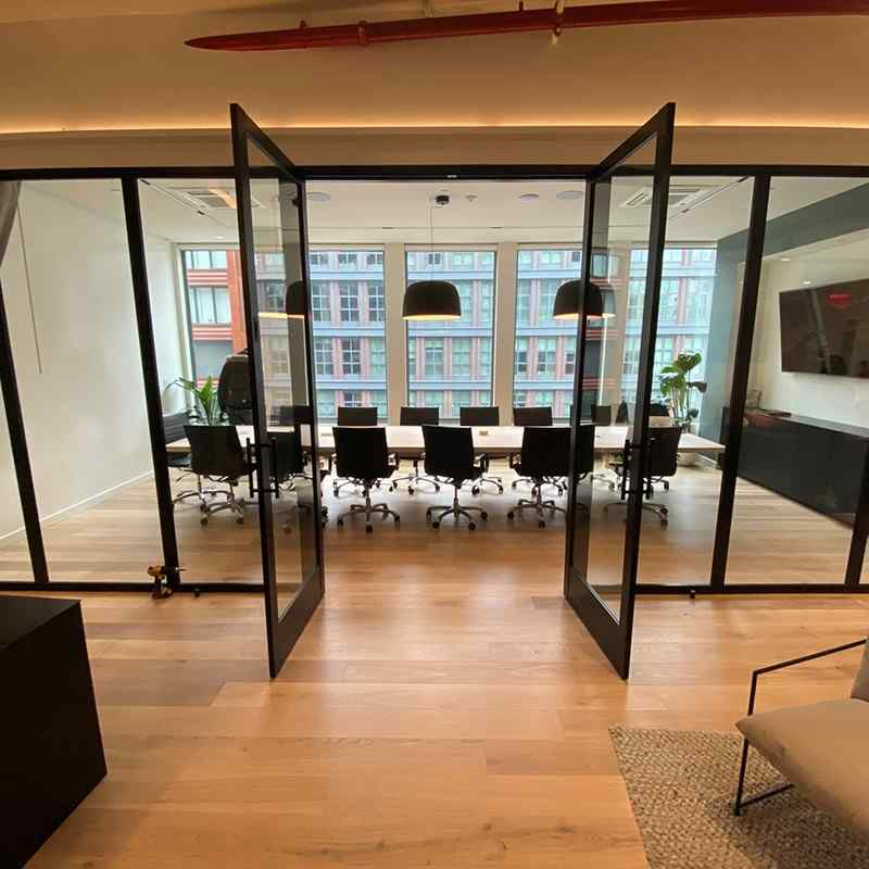 conference room with clear glass walls and clear swing doors