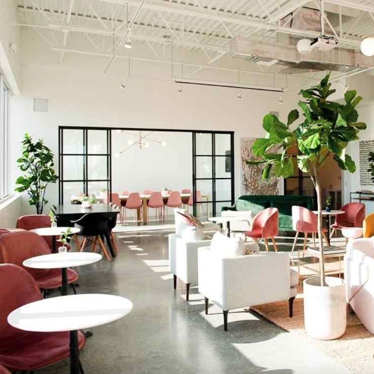 conference room with glass slide doors and pink chairs