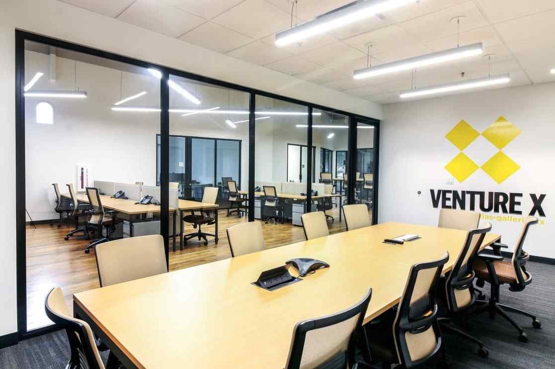 conference room with glass wall panels and glass swing door