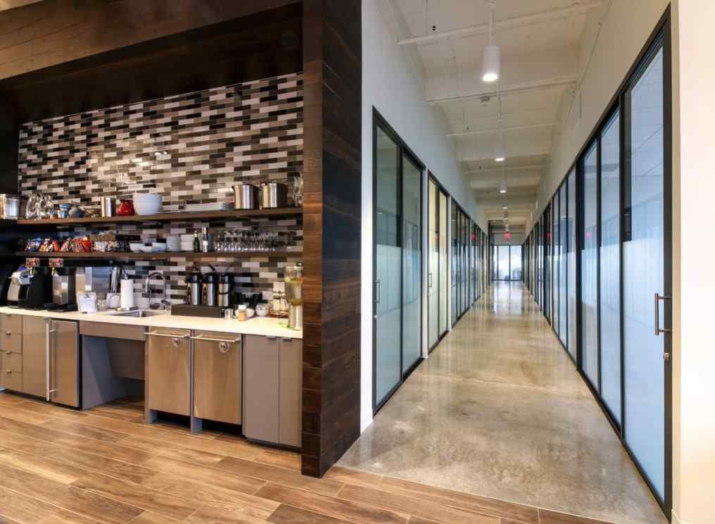 corporate hallway of offices with glass panels and doors
