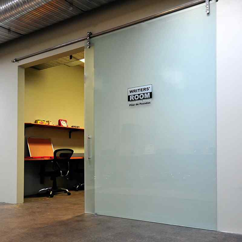 office glass barn door with custom name and title decal