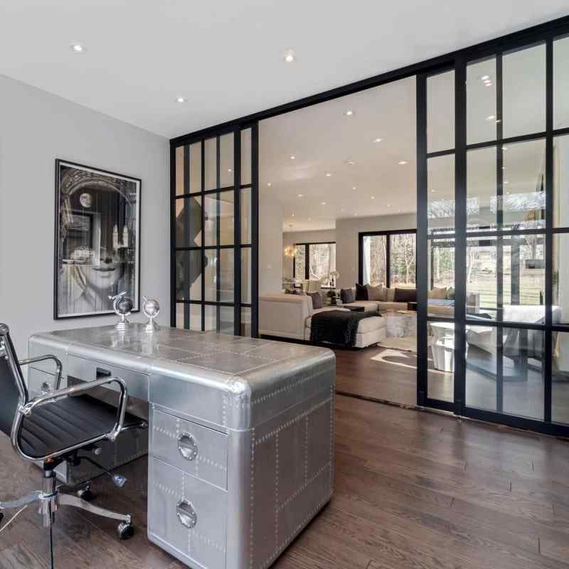 home office custom floor to ceiling glass walls and sliding glass doors