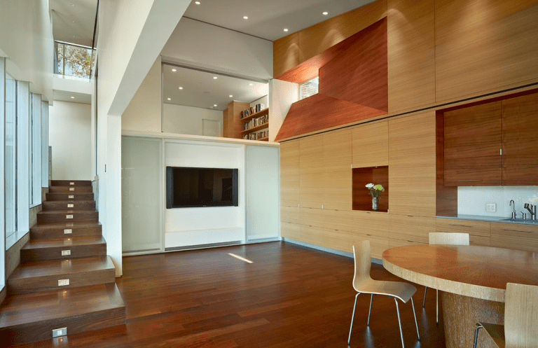 modern living room with wooden floor and stairs