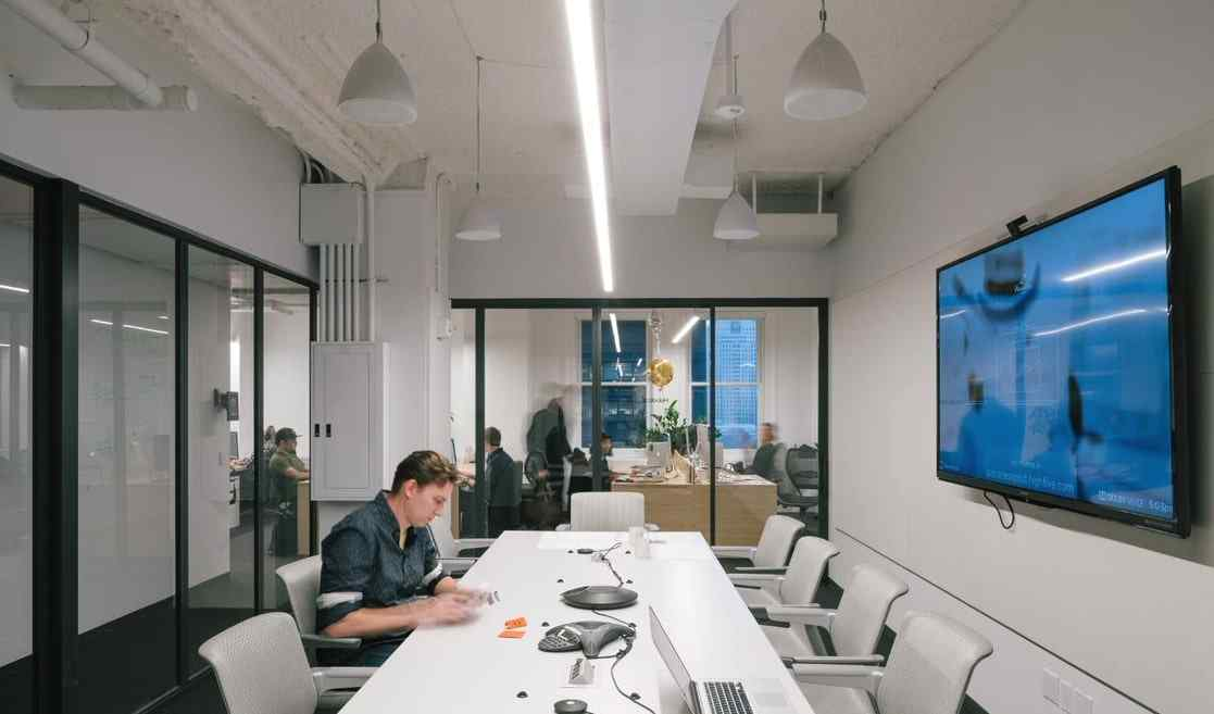 office conference room with glass fixed wall panels and bypassing slide door
