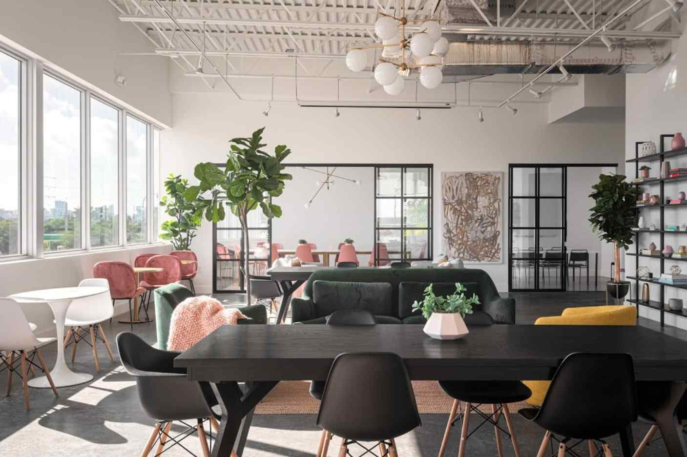 open coworking space with back conference room with sliding glass door room divider
