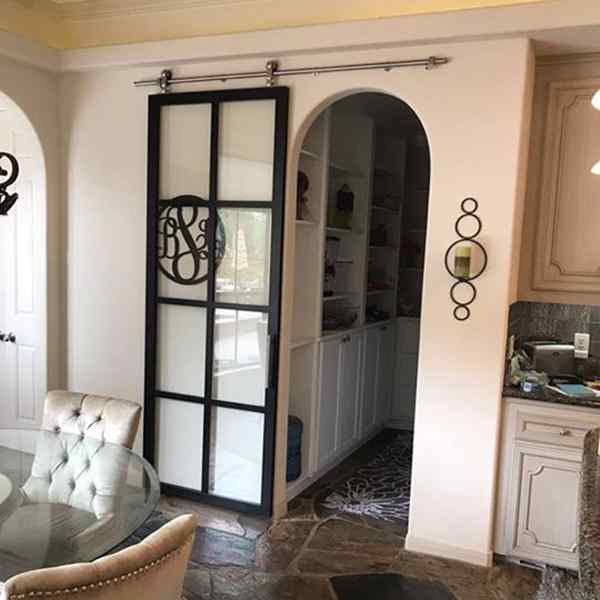 suspended barn door black frame clear glass kitchen home